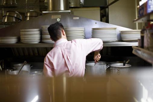 Restaurateur working in kitchen