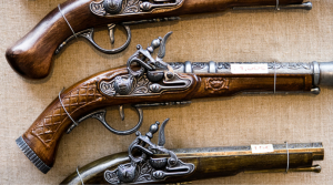 close up of antique guns